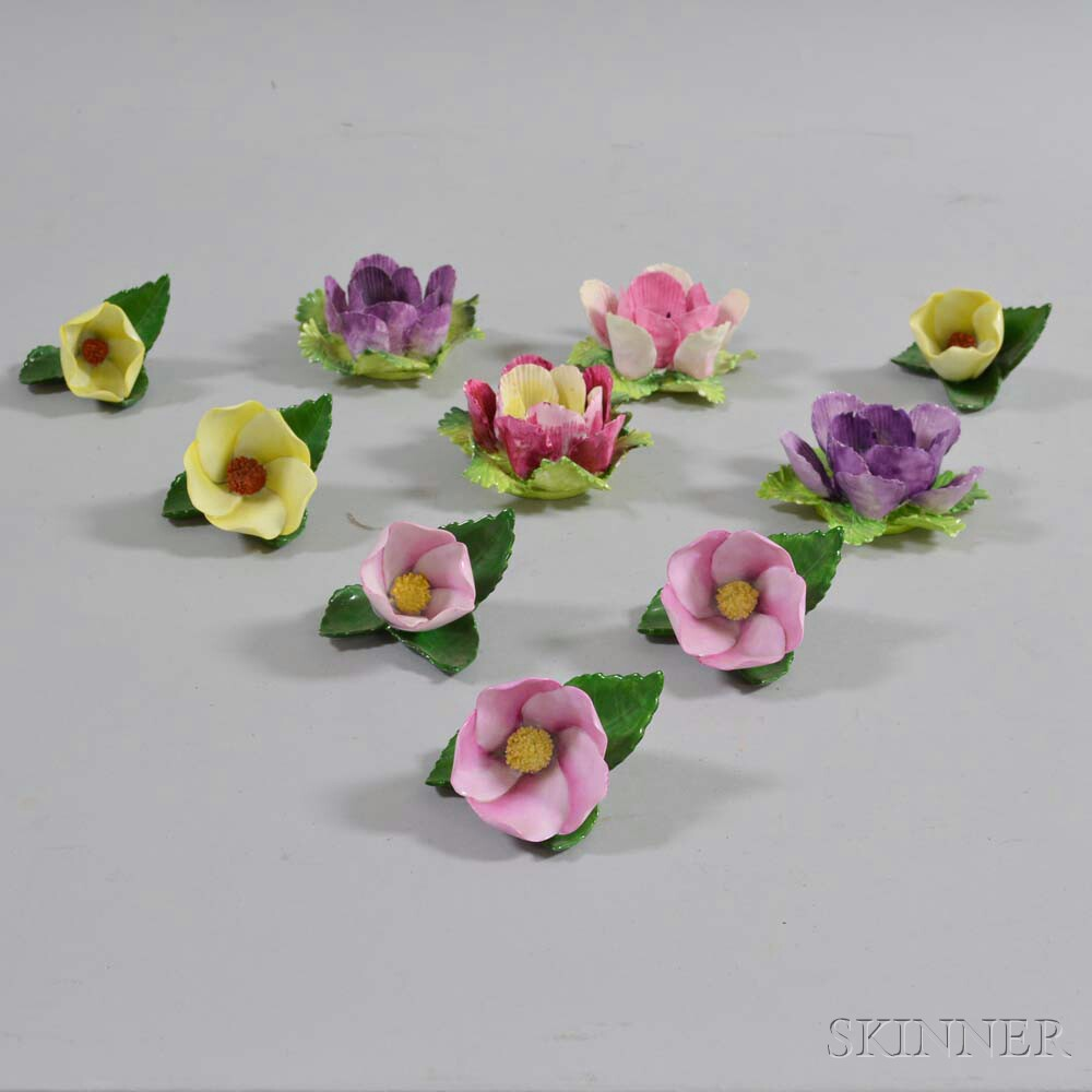 Ten Herend and Crown Staffordshire Porcelain Flowers.     Estimate $200-250