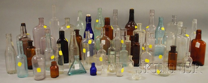 Approximately Fifty-five Assorted Mostly Colorless and Brown Amber Molded Glass   Bottles