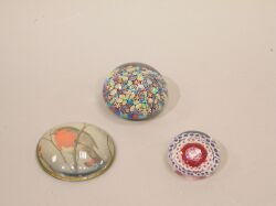 Three Glass Paperweights.