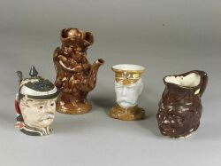 Group of Four Pottery Character Jugs