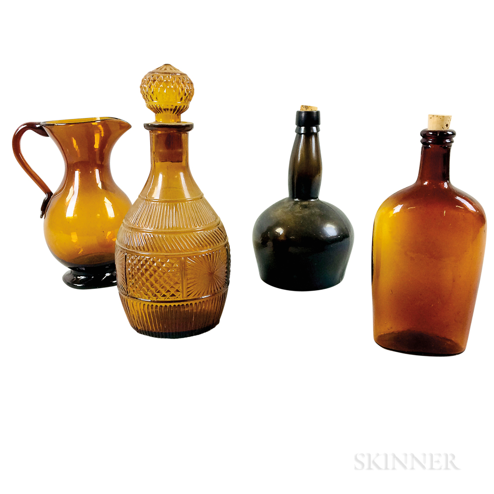 Four Amber Glass Vessels