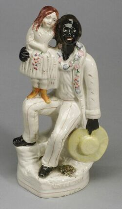 Staffordshire Figure of Uncle Tom and Eva