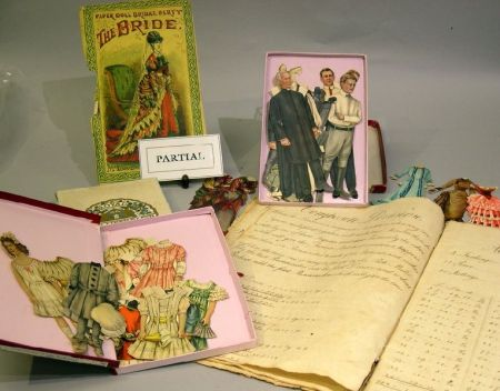 A Child's Collection of Paper Dolls and Ephemera