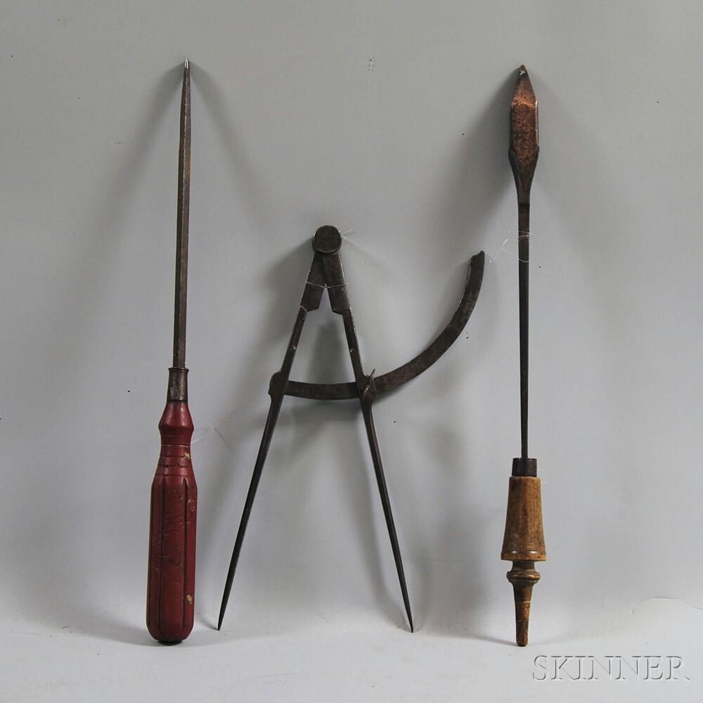 Three Oversized Hand Tools