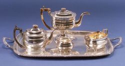 Four-piece Assembled Silver Plated Tea Service with a Tray.