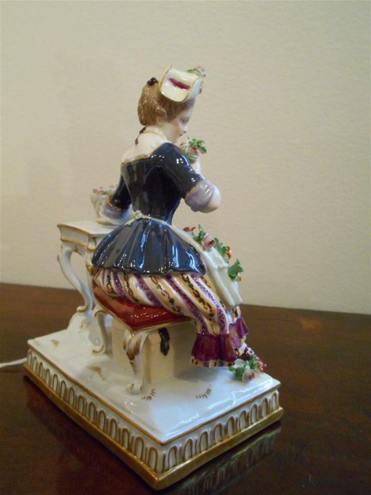 Meissen Porcelain Figure of a Lady with Flowers