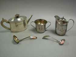 Coin Silver Creamer, Two Spoons, English Sterling Silver Teapot and Two-Handled Cup.