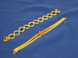 14kt Gold and Ruby Bracelet and a 14kt Gold Textured Bracelet.
