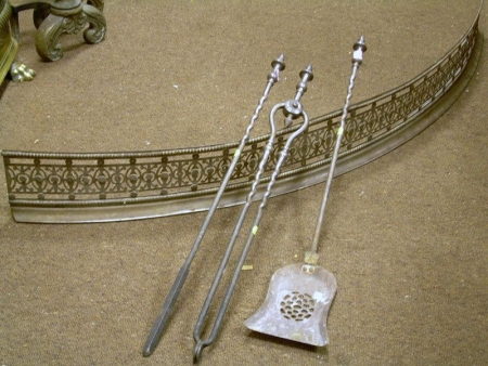 Bowed Pierced Steel Fireplace Fender and a Set of Three Steel Fireplace Tools.