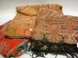 Four Woven Wool Paisley Shawls.