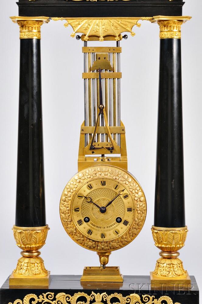 Ebonized Two-column Inverted Swinging Clock