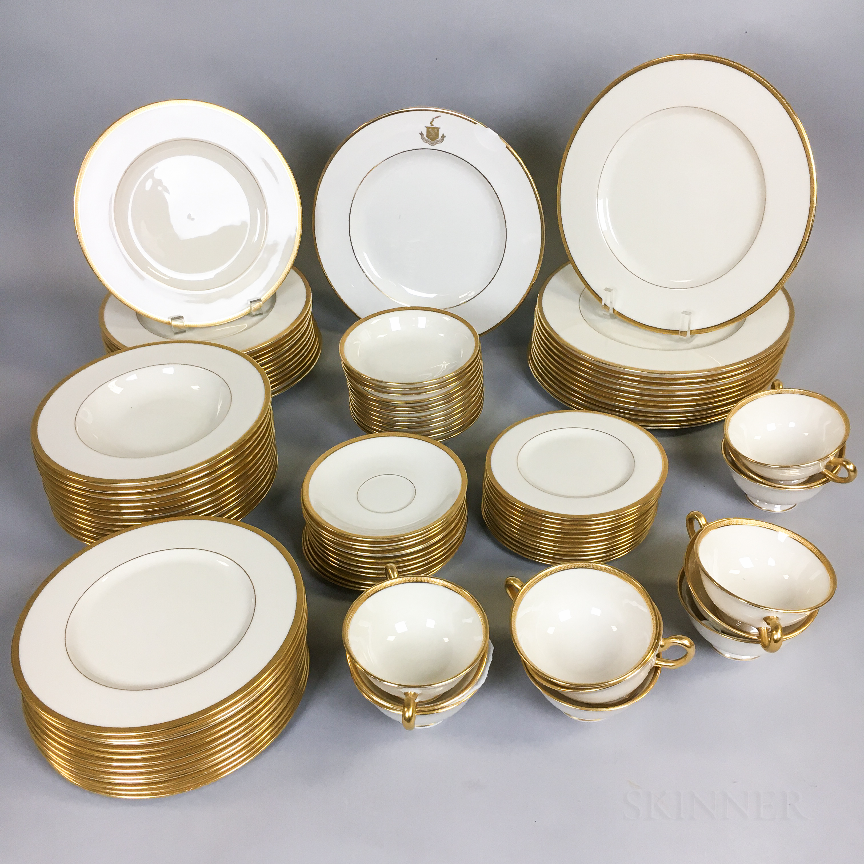 Lenox Gilt-rimmed Porcelain Dinner Service for Twelve.     Estimate $200-300