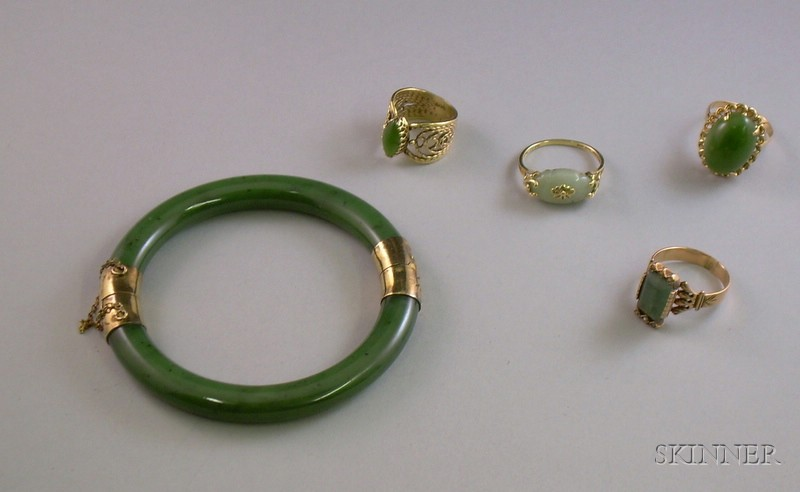 Four 14kt Gold Jade or Quartz Rings and a Jade and Gilt Silver Bangle