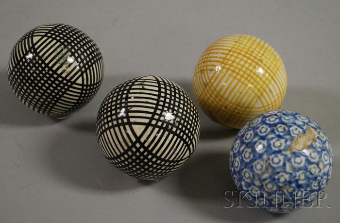 Four Glazed Stoneware Carpet Balls