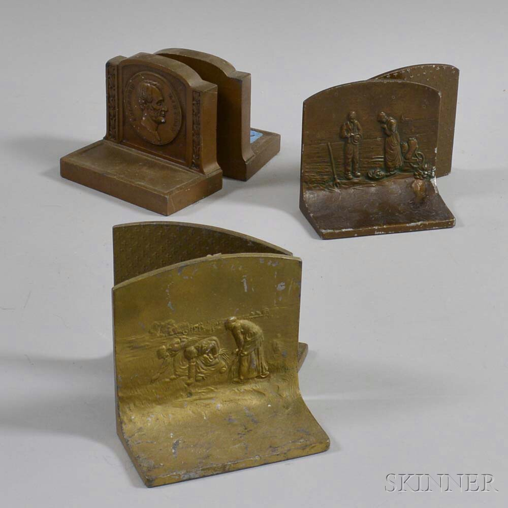 Three Pairs of Bronzed Metal and Clad Bookends