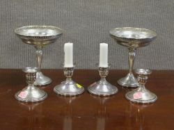 Pair of Sterling Silver Compotes and a Set of Four Sterling Candleholders.