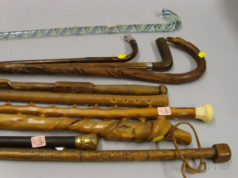 Six Assorted Walking Sticks and Four Canes
