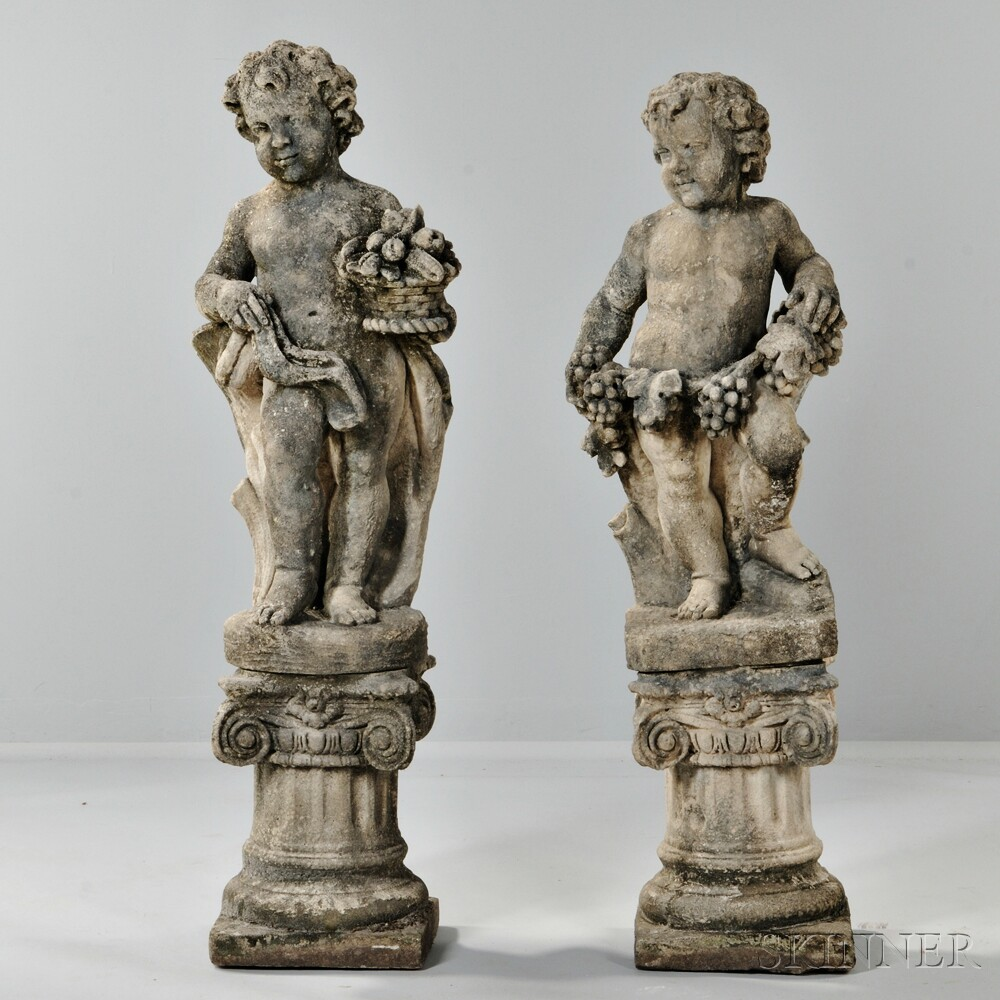 Pair of Stone Putti Figures with Fruit