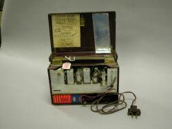 1952 Fada P111 Maroon Plastic Flip-Front Portable Radio.