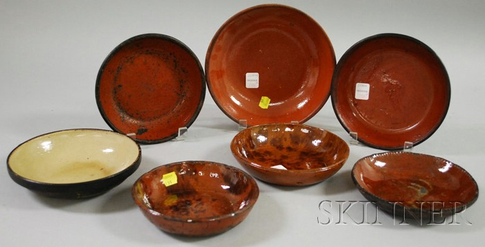Fifteen Assorted Glazed Redware Dishes and Bowls