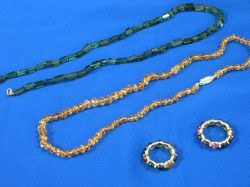 Faceted Citrine and Tourmaline Beaded Necklaces and Two Cabochon Stone Rings.