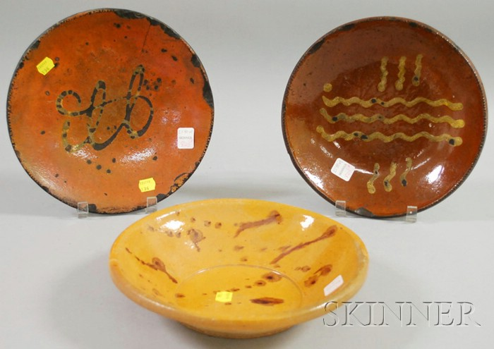 Two Slip-decorated Redware Dishes and a Glazed Pottery Bowl