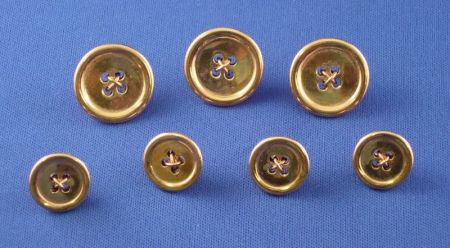 Three Large and Four Small 14kt Gold Blazer Buttons.