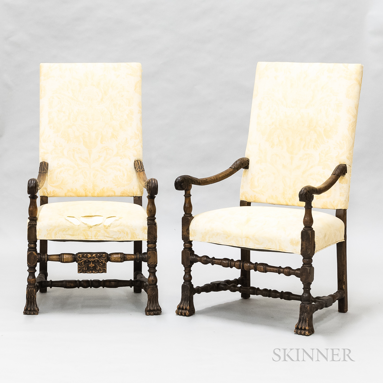 Two Flemish Carved and Upholstered Walnut Armchairs