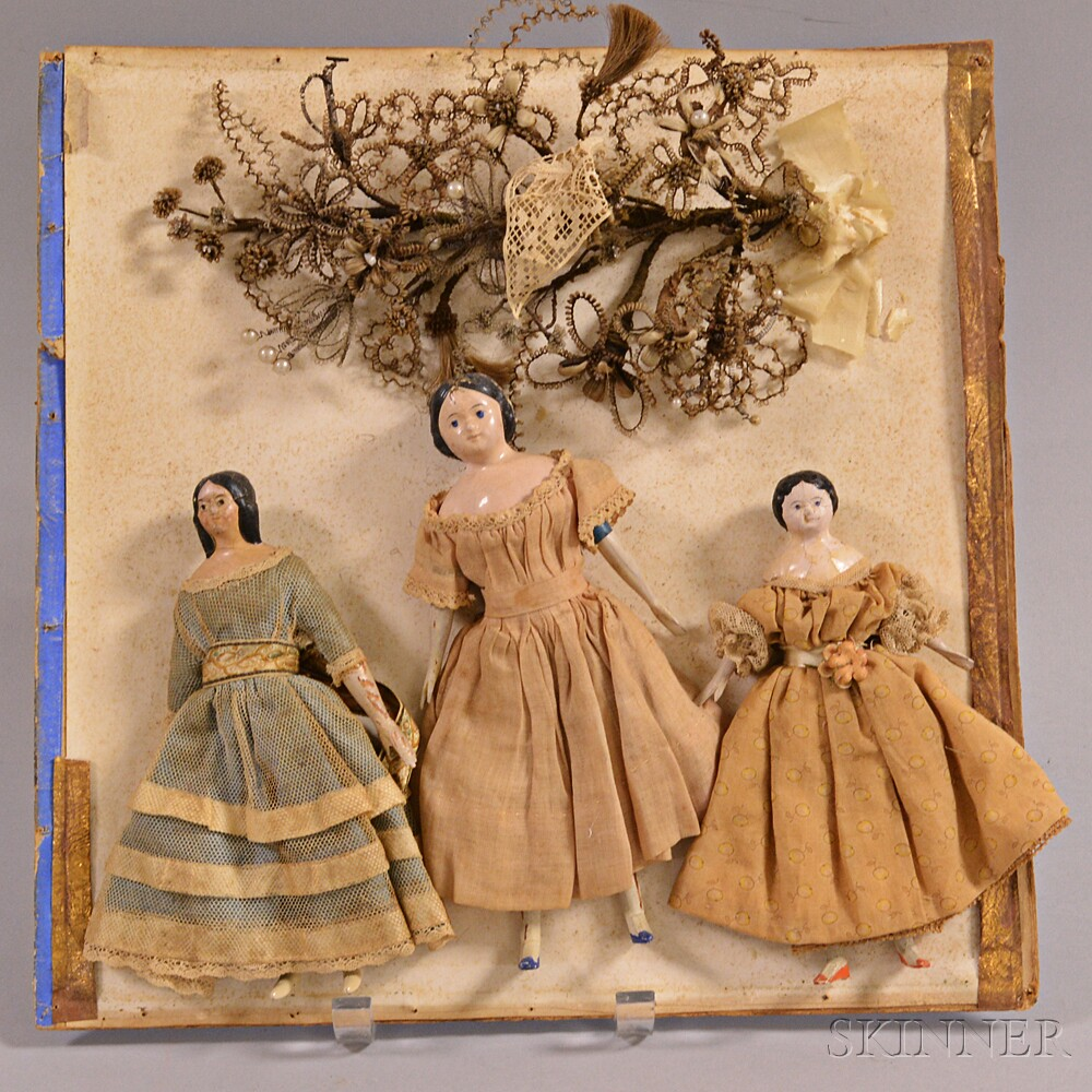 Three Small Papier-mache Dolls and a Hair Bouquet.     Estimate $200-250
