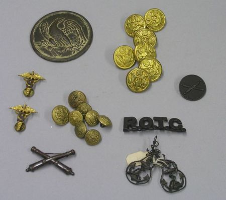 Cast Metal Eagle Medallion, Fifteen U.S. Military Buttons, and Six Insignia Pins.