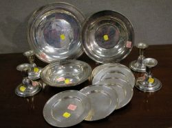 Set of Four Sterling Silver Candleholders and Eight Dishes and Bowls.