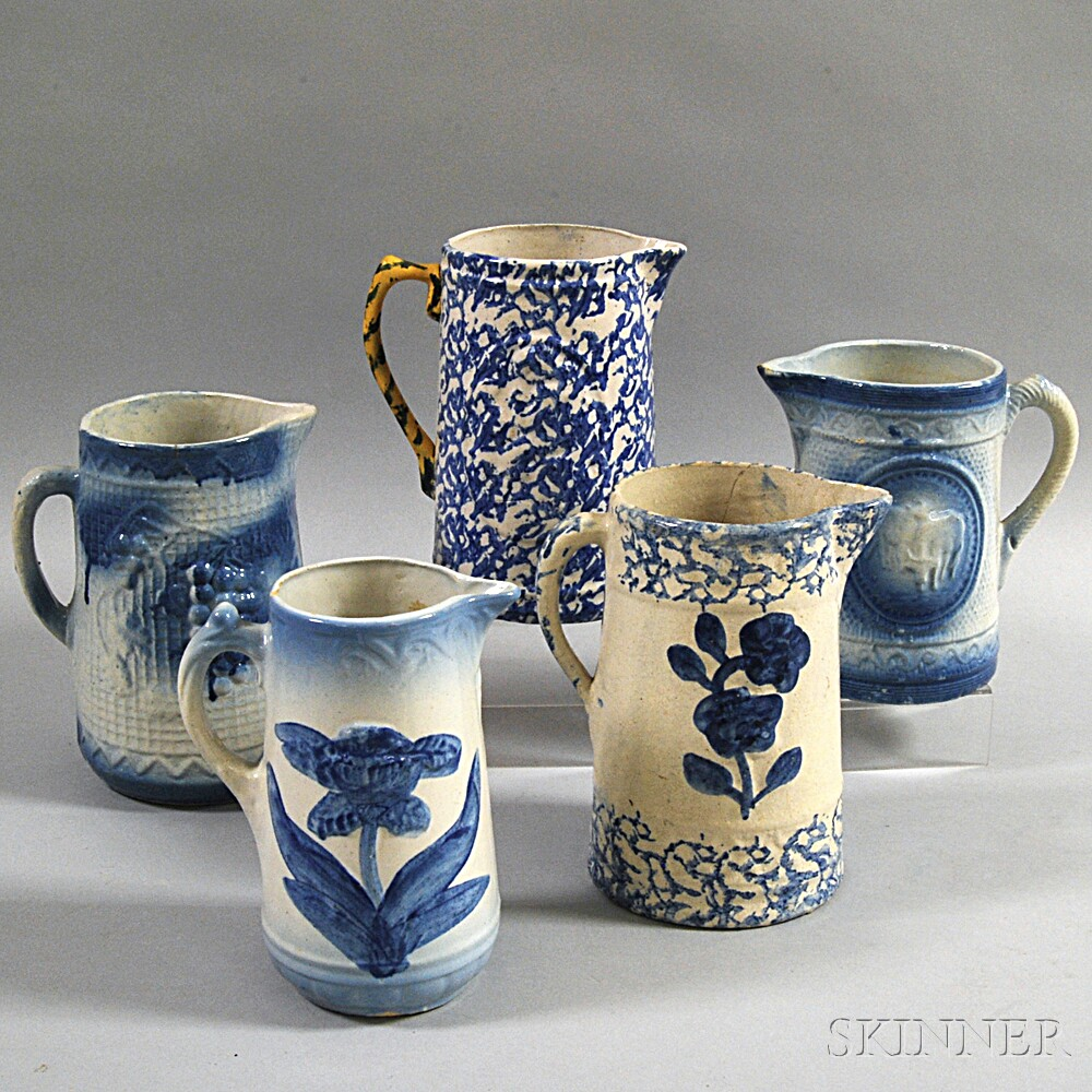 Five Blue and White Stoneware Pitchers
