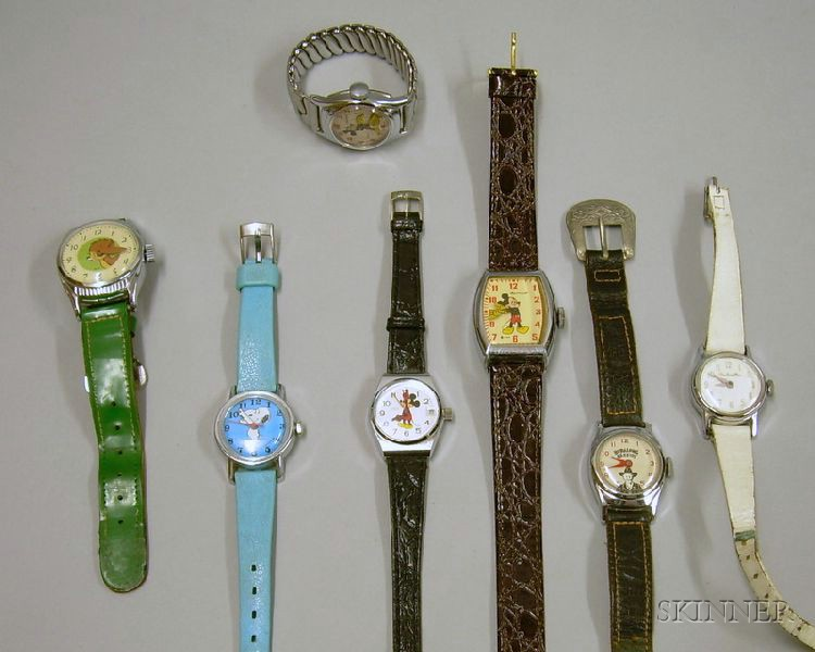 Three Mickey Mouse and Four Other Character Novelty Wristwatches