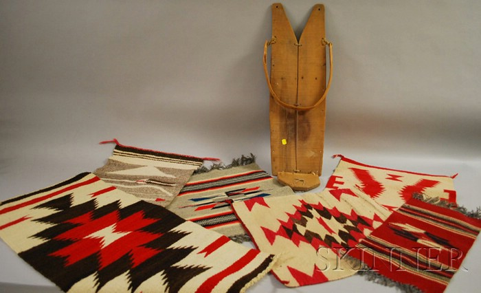 Southwest Cradleboard, Four Small Navajo Textiles and Two Chimayo Weavings.