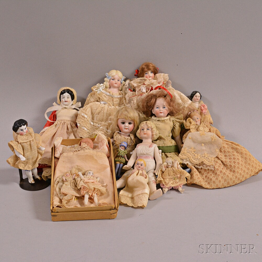 Fourteen Small Bisque Dollhouse Dolls.     Estimate $100-200