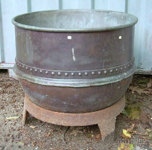 Large Riveted Metal Kettle on Stand.