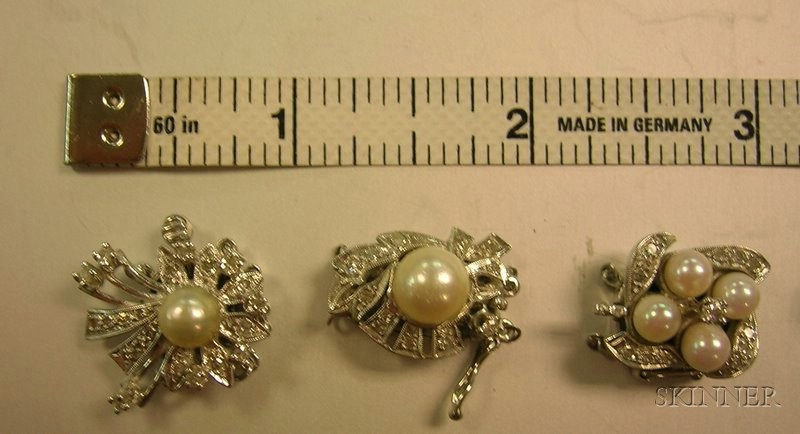 Five White Gold, Diamond, and Pearl Clasps