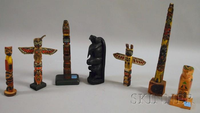 Seven Wooden Painted Tourist Totem Poles
