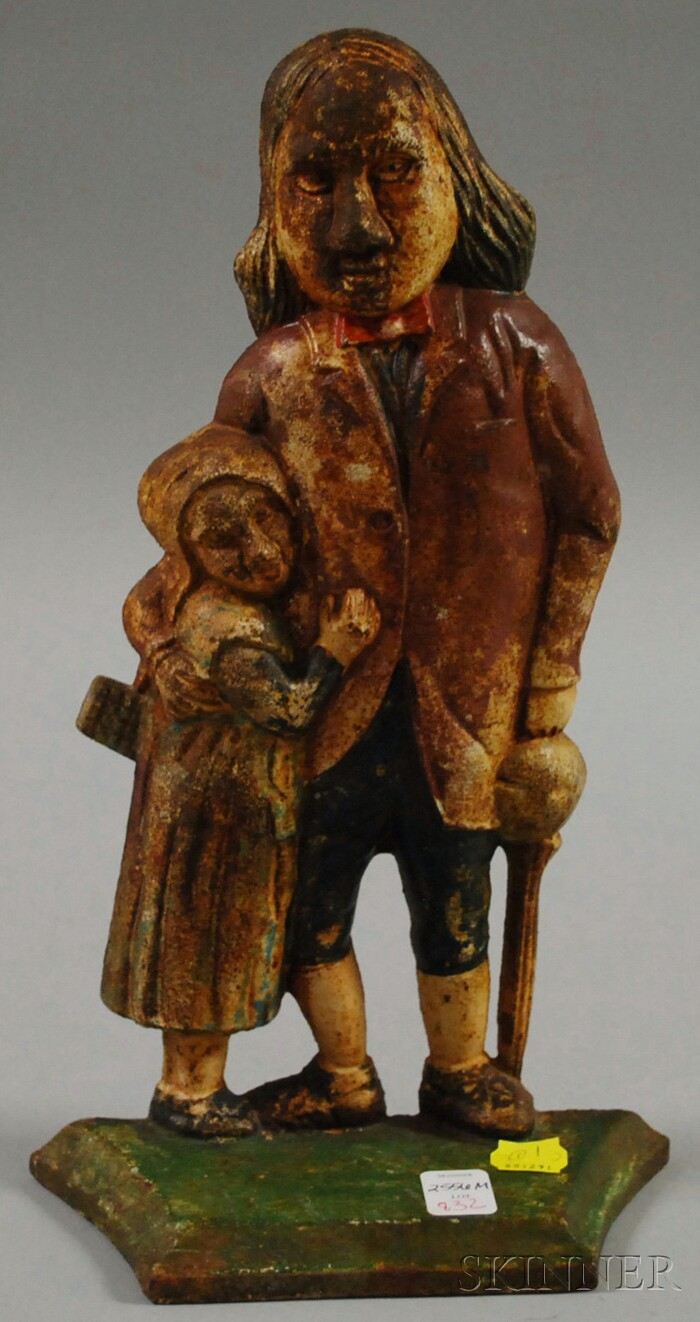 Painted Cast Iron Mr. Peggotty and Little Agnes Doorstop and a Fireplace Doorstop