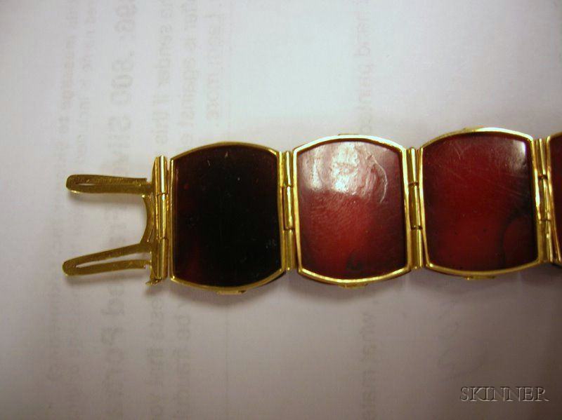 18kt Gold and Carved Amber Buddha Panel Bracelet and a Carved Jade, Quartz and Seed   Pearl Brooch