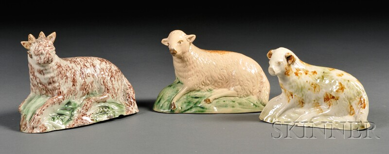 Three Staffordshire Earthenware Sheep