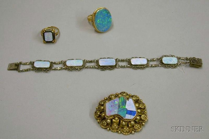 Two 14kt Gold and Opal Rings, a Sterling Silver and Opal Bracelet, and a Gilt   Sterling Silver and Opal Brooch