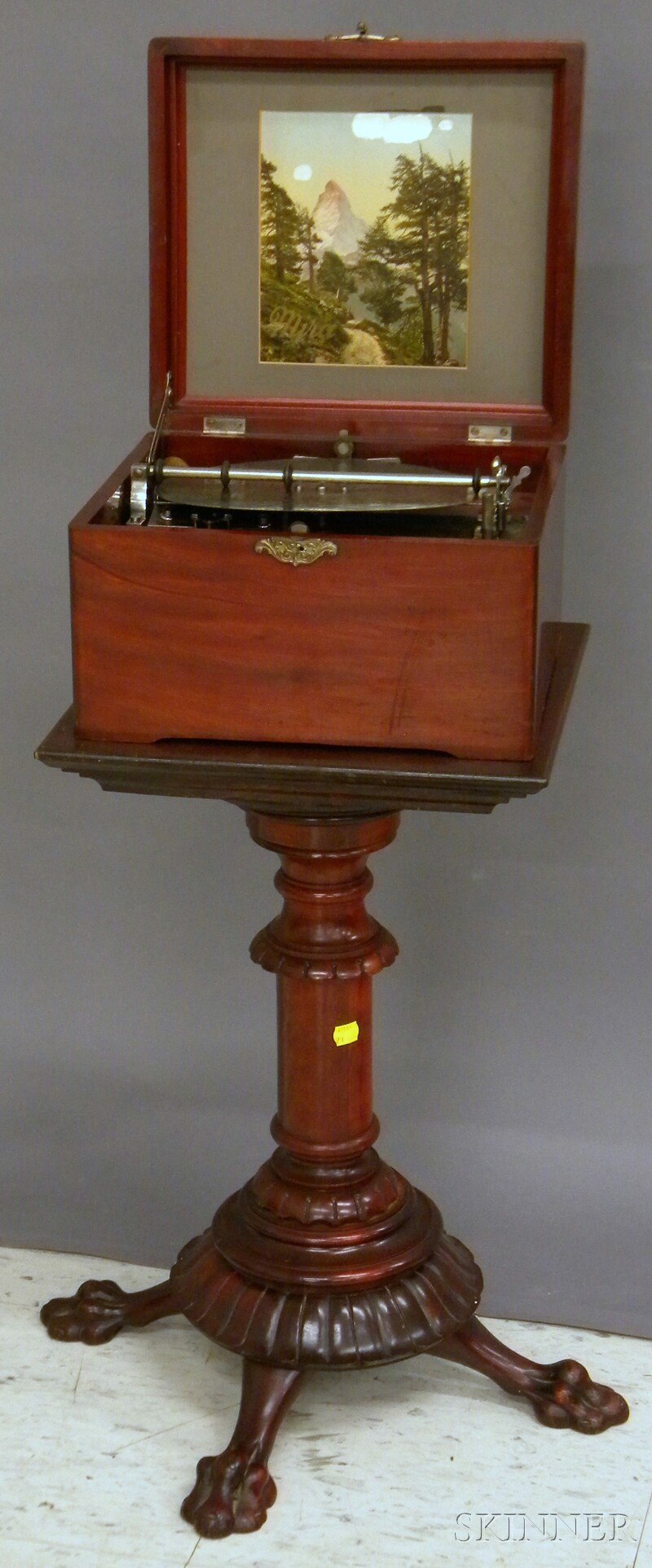 Swiss Mahogany Cased Mechanical 9 1/4-in. Disc Music Player with a Carved Mahogany   Stand
