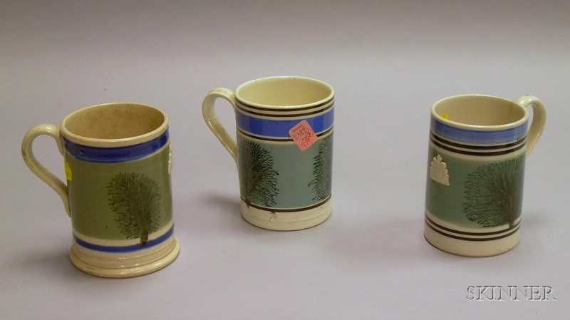Three Seaweed Decorated Mochaware Mugs.