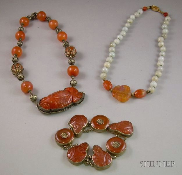 Two Asian Carved Chalcedony and Silver Necklaces and a Bracelet.