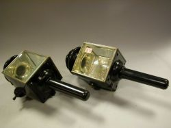 Pair of Black Painted Metal and Beveled Glass Carriage Lamps.