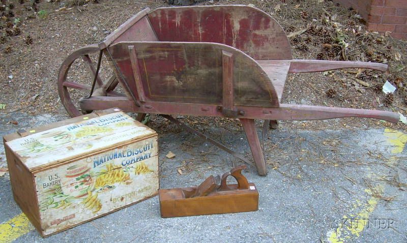 Country Red-painted Wooden Wheelbarrow, a National Biscuit Co. Chromolithograph Labeled Wooden Retail Box, and a Wood Plane.