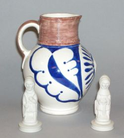Three  Wedgwood Items, comprising a Queen Victoria jug and two chess pieces.