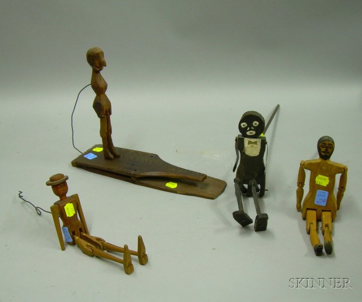 Four Folk Carved and Painted Wooden Articulated Dancing Figure Toys.