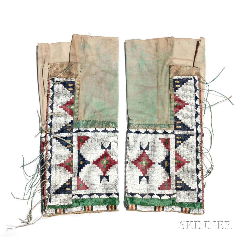 Pair of Arapaho Woman's Beaded Hide and Cloth Leggings